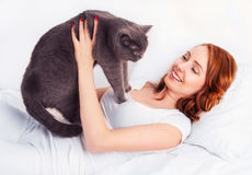 Woman with a cat Royalty Free Stock Images