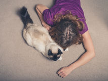 Woman with cat on carpet Stock Photo