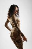 Woman-cat in catsuit of leopard Royalty Free Stock Image