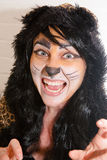 Woman in Cat Costume. Woman wearing a cheetah cat costume for Halloween Stock Photo