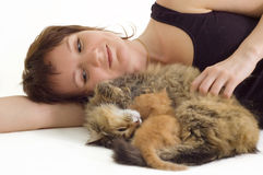 Woman with cat and kitten Stock Image