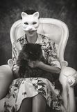 A woman with a cat mask stock photo