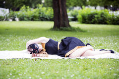 Woman  with cat mask lay on ground Stock Photo