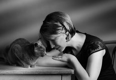 Woman and Cat Stock Images