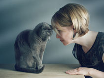 Woman and Cat. Portrait of an adult Woman with her purebred Russian Blue Cat stock images