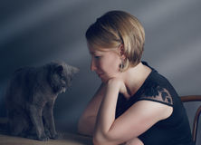 Woman and Cat stock photos