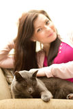 Woman and cat sitting on a sofa Royalty Free Stock Images