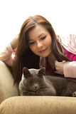 Woman and cat sitting on a sofa Stock Images