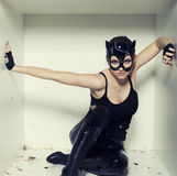 Woman in cat suit close up covered feathers. Sexy look for fashion party Stock Photo