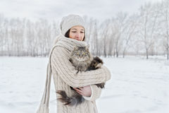 Woman with a cat in winter Stock Photo