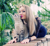 Woman with cat. Young beautyful woman playing with cat Royalty Free Stock Photo