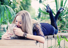 Woman with cat. Young beautyful woman playing with cat Stock Photo