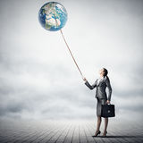 Woman catch Earth planet Stock Images