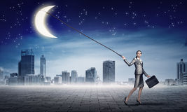 Woman catch moon Royalty Free Stock Images