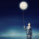 Woman catch moon Stock Images