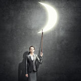 Woman catch moon Royalty Free Stock Photography