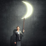 Woman catch moon Royalty Free Stock Image
