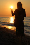 Woman catch the sunrise Royalty Free Stock Images