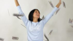 Woman catches the money. Slow motion stock video footage