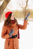 Woman catches snow Royalty Free Stock Image