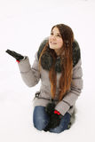 Woman catches snowflakes Royalty Free Stock Photos