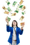 Woman Catching Money. Girl catching money falling from the sky Stock Photo