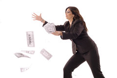 Woman catching money in the air. Shot of a woman catching money in the air Stock Images