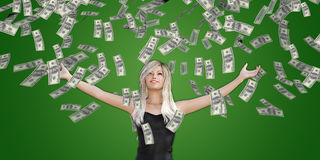 Woman Catching Money Falling From the Sky. In US Dollars Royalty Free Stock Image