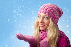 Woman catching snowflakes Royalty Free Stock Image