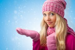 Woman catching snowflakes Stock Image