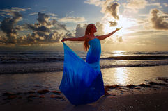 Woman catching the sun Royalty Free Stock Image