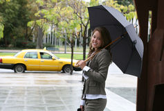 Woman Catching a Taxi Stock Images