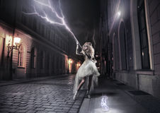 Woman catching thunderbolts Stock Photo