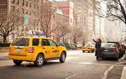 Woman catchs taxi in New York Stock Images