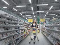 A woman of caucasian appearance makes purchases at the supermarket. Russia, summer 2017. Royalty Free Stock Photo