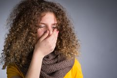 Woman caught a cold, her throat inflamed. A young woman caught a cold, her throat inflamed, cough, flu Royalty Free Stock Images