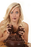 Woman caught with hands in cake Royalty Free Stock Photos