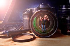 Woman in lens stock photography