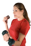 Woman caught snacking during workout Royalty Free Stock Photography