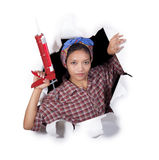 Woman with caulking gun tool Stock Photo