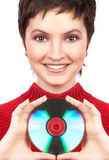 Woman with cd. Young woman holding a cd-rom. Isolated over white royalty free stock photography