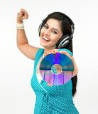 Woman with cd and headset. Female grooving to the music Stock Image