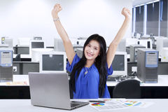 Woman celebrate her achievement in office Stock Image