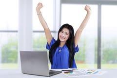 Woman celebrates her accomplishment Stock Photo