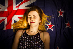 Woman celebrating Australia Day on Australian flag Stock Photography