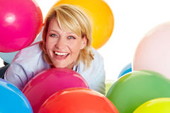 Woman celebrating with balloons Stock Images