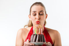 Woman celebrating birthday with cake and candles Royalty Free Stock Image