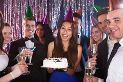 Woman celebrating birthday with friends at nightclub Royalty Free Stock Image