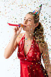 Woman celebrating birthday with streamer and party hat Royalty Free Stock Images