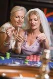 Woman celebrating bridal shower in casino. Gambling Stock Image